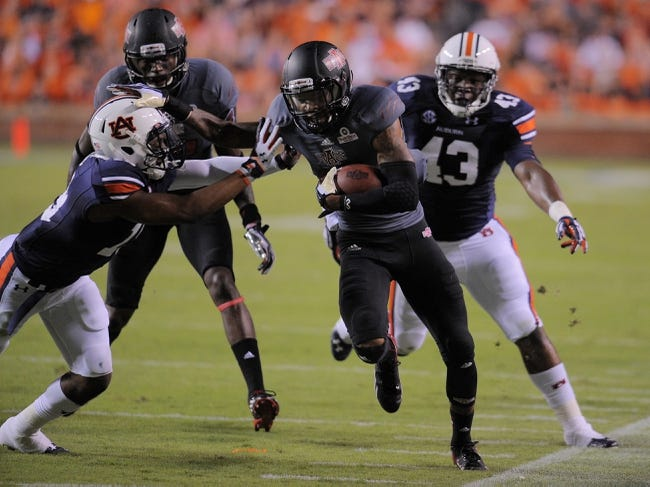 Sep 7, 2013; Auburn, AL, USA; Arkansas State Red Wolves wide receiver Tres Houston (15) runs the ball past Auburn Tigers defensive back Jordan Spriggs (43) during the first half at Jordan Hare Stadium. Mandatory Credit: Shanna Lockwood-USA TODAY Sports