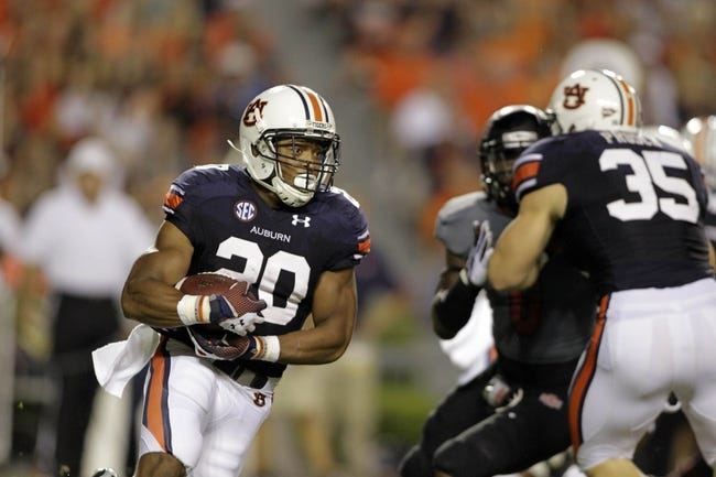 Sep 7, 2013; Auburn, AL, USA; Auburn Tigers running back Corey Grant (20) carries against the Arkansas State Red Wolves during the first half at Jordan Hare Stadium.  Mandatory Credit: John Reed-USA TODAY Sports