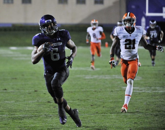 Sep 7, 2013; Evanston, IL, USA; Northwestern Wildcats wide receiver Tony Jones (6) catches a touch down pass in front of Syracuse Orange cornerback Julian Whigham (21) during the fourth quarter at Ryan Field. Mandatory Credit: David Banks-USA TODAY Sports