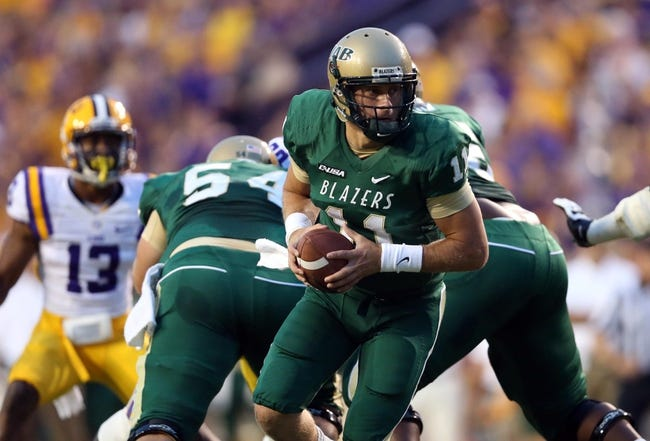Sep 7, 2013; Baton Rouge, LA, USA; UAB Blazers quarterback Austin Brown (11) prepares to hand the ball off against the LSU Tigers during the first quarter at Tiger Stadium. Mandatory Credit: Crystal LoGiudice-USA TODAY Sports