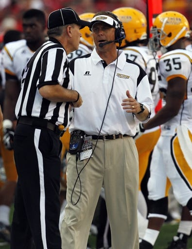 Sep 7, 2013; Lincoln, NE, USA; Southern Mississippi Golden Eagles head coach Todd Monken talks to an official during the game against the Nebraska Cornhuskers in the second quarter at Memorial Stadium. Nebraska won 56-13. Mandatory Credit: Bruce Thorson-USA TODAY Sports