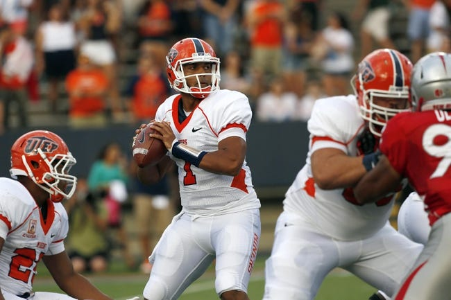 Sep 7, 2013; El Paso, TX, USA; UTEP Miners quarterback Jameill Showers (1) drops back for a pass against the New Mexico Lobos at Sun Bowl Stadium. Mandatory Credit: Ivan Pierre Aguirre-USA TODAY Sports