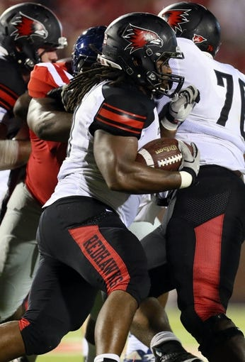 Sep 7, 2013; Oxford, MS, USA; Southeast Missouri State Redhawks defensive back Cantrell Andrews (24) carries the ball up the field during the second half against the Mississippi Rebels at Vaught-Hemingway Stadium. Mandatory Credit: Spruce Derden-USA TODAY Sports