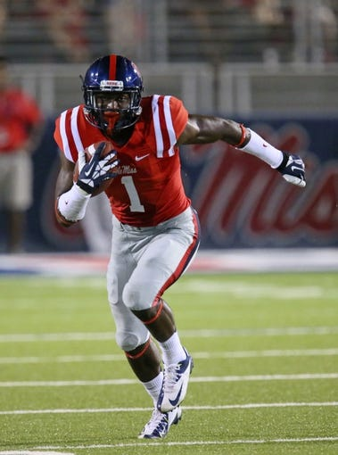 Sep 7, 2013; Oxford, MS, USA; Mississippi Rebels wide receiver Laquon Treadwell (1) carries the ball up the filed during the second half against the Southeast Missouri State Redhawks at Vaught-Hemingway Stadium. Mandatory Credit: Spruce Derden-USA TODAY Sports