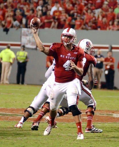 Sep 7, 2013; Raleigh, NC, USA;   North Carolina State Wolfpack quarterback Pete Thomas (4) passes during the second half against the Richmond Spiders. North Carolina State won 23-21. Mandatory Credit: Rob Kinnan-USA TODAY Sports