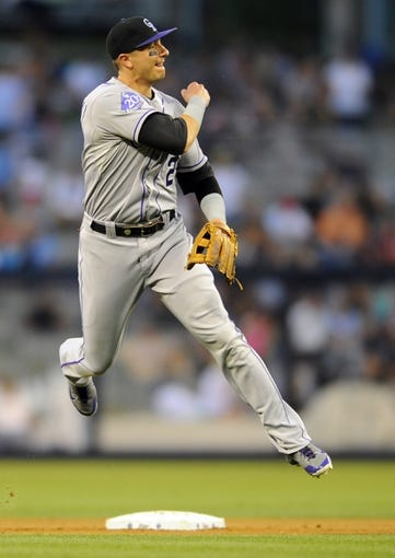 Sep 7, 2013; San Diego, CA, USA; Colorado Rockies shortstop Troy Tulowitzki (2) throws to first for the final out of the fifth inning against the San Diego Padres at Petco Park. Mandatory Credit: Christopher Hanewinckel-USA TODAY Sports