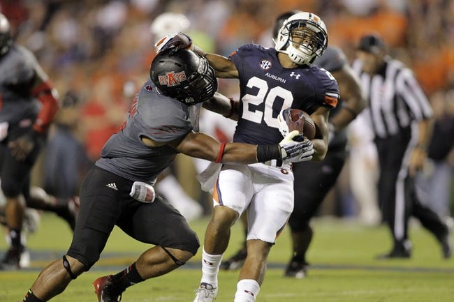 Sep 7, 2013; Auburn, AL, USA; Arkansas State Red Wolves defensive back Kyle Coleman tackles Auburn Tigers running back Corey Grant (20) during the second half at Jordan Hare Stadium.  Mandatory Credit: John Reed-USA TODAY Sports