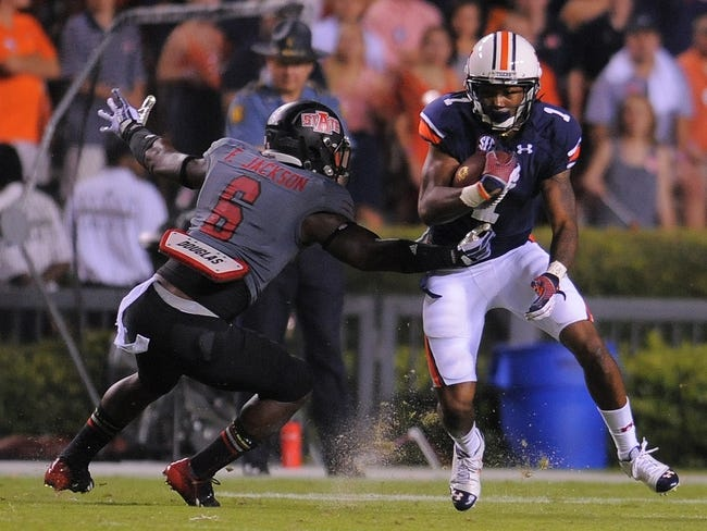 Sep 7, 2013; Auburn, AL, USA;  Auburn Tigers linebacker Kris Frost (17) runs the ball as Arkansas State Red Wolves running back Frankie Jackson (6) goes in for a tackle at Jordan Hare Stadium. Mandatory Credit: Shanna Lockwood-USA TODAY Sports