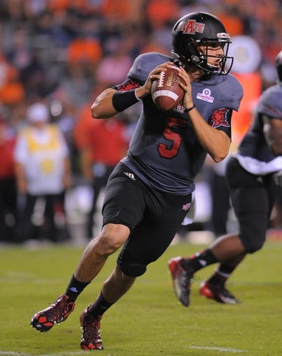 Sep 7, 2013; Auburn, AL, USA; Arkansas State Red Wolves quarterback Adam Kennedy (5) looks to pass against the Auburn Tigers at Jordan Hare Stadium. Mandatory Credit: Shanna Lockwood-USA TODAY Sports