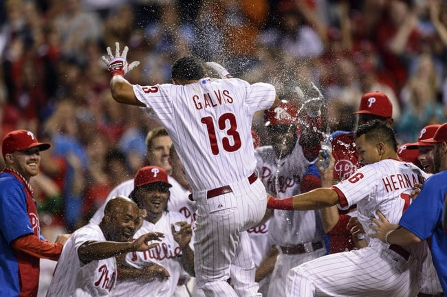 Sep 7, 2013; Philadelphia, PA, USA; Philadelphia Phillies shortstop Freddy Galvis (13) celebrates his game winning walk off home run during the ninth inning against the Atlanta Braves at Citizens Bank Park. The Phillies defeated the Braves 6-5. Mandatory Credit: Howard Smith-USA TODAY Sports