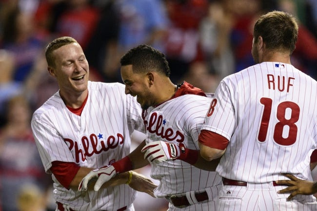 Sep 7, 2013; Philadelphia, PA, USA; Philadelphia Phillies shortstop Freddy Galvis (13) celebrates hitting a game winning walk off home run with third baseman Cody Asche (25) and left fielder Darin Ruf (18) during the ninth inning against the Atlanta Braves at Citizens Bank Park. The Phillies defeated the Braves 6-5. Mandatory Credit: Howard Smith-USA TODAY Sports