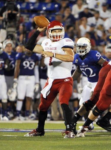 Sep 7, 2013; Lawrence, KS, USA; South Dakota Coyotes quarterback Josh Vander Maten (7) throws a pass against the Kansas Jayhawks in the second half at Memorial Stadium. Kansas won the game 31-14. Mandatory Credit: John Rieger-USA TODAY Sports