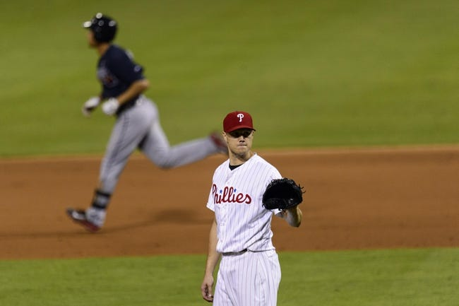 Sep 7, 2013; Philadelphia, PA, USA; Philadelphia Phillies pitcher Jonathan Papelbon (58) waits for a new ball after giving up a game tying two run home to Atlanta Braves shortstop Andrelton Simmons (19) during the ninth inning at Citizens Bank Park. The Phillies defeated the Braves 6-5. Mandatory Credit: Howard Smith-USA TODAY Sports