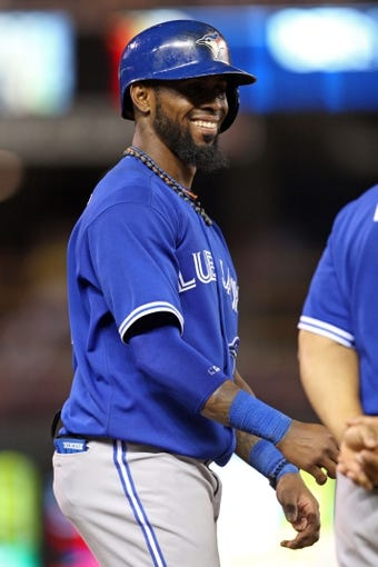 Sep 7, 2013; Minneapolis, MN, USA; Toronto Blue Jays shortstop Jose Reyes (7) smiles during the ninth inning against the Minnesota Twins at Target Field. The Blue Jays won 11-2. Mandatory Credit: Jesse Johnson-USA TODAY Sports