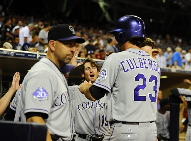 Sep 7, 2013; San Diego, CA, USA; Colorado Rockies infielder charlie Culberson (23) is congratulated by teammates after scoring the tying run during the eighth inning against the San Diego Padres at Petco Park. Mandatory Credit: Christopher Hanewinckel-USA TODAY Sports