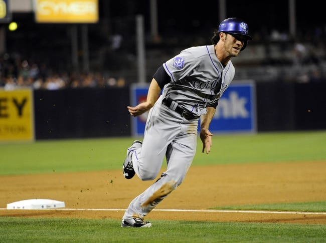 Sep 7, 2013; San Diego, CA, USA; Colorado Rockies infielder charlie Culberson (23) rounds third base and scores to tie the game during the eighth inning against the San Diego Padres at Petco Park. Mandatory Credit: Christopher Hanewinckel-USA TODAY Sports