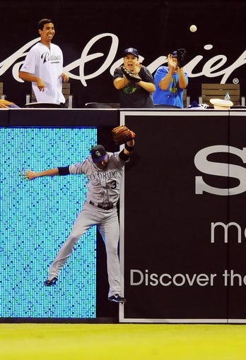 Sep 7, 2013; San Diego, CA, USA; Colorado Rockies right fielder Michael Cuddyer (3) is unable to catch a home run ball hit by San Diego Padres second baseman Jedd Gyorko (not pictured) during the eighth inning at Petco Park. Mandatory Credit: Christopher Hanewinckel-USA TODAY Sports