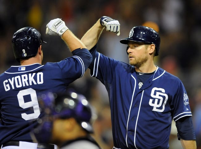 Sep 7, 2013; San Diego, CA, USA; San Diego Padres second baseman Jedd Gyorko (9) is congratulated by third baseman Chase Headley (7) after a go-ahead home run during the eighth inning against the Colorado Rockies at Petco Park. Mandatory Credit: Christopher Hanewinckel-USA TODAY Sports