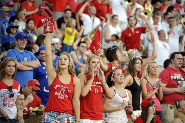 Sep 7, 2013; Lawrence, KS, USA; South Dakota Coyotes fans cheer in the first half against the Kansas Jayhawks at Memorial Stadium. Kansas won the game 31-14. Mandatory Credit: John Rieger-USA TODAY Sports