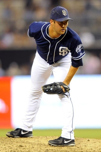 Sep 7, 2013; San Diego, CA, USA; San Diego Padres relief pitcher Huston Street (16) looks in for a sign during the ninth inning against the Colorado Rockies at Petco Park. Mandatory Credit: Christopher Hanewinckel-USA TODAY Sports