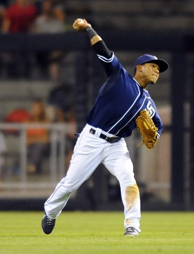 Sep 7, 2013; San Diego, CA, USA; San Diego Padres center fielder Alexi Amarista (5) throws the ball to first base for the game-ending double play during the ninth inning against the Colorado Rockies at Petco Park. The Padres won 2-1. Mandatory Credit: Christopher Hanewinckel-USA TODAY Sports