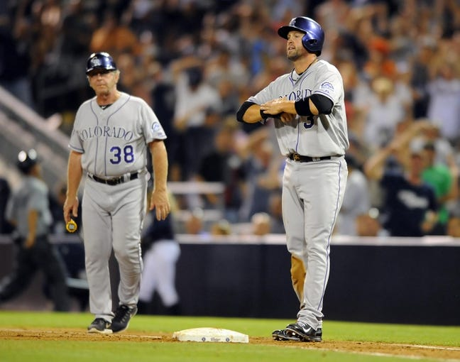 Sep 7, 2013; San Diego, CA, USA; Colorado Rockies right fielder Michael Cuddyer (3) reacts after being doubled off first base on a force play by San Diego Padres first baseman Kyle Blanks (not pictured) during the ninth inning  at Petco Park. The Padres won 2-1. Mandatory Credit: Christopher Hanewinckel-USA TODAY Sports
