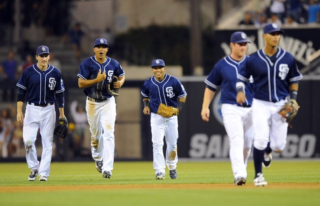 Sep 7, 2013; San Diego, CA, USA; San Diego Padres celebrate after a game ending double play in the ninth inning against the Colorado Rockies at Petco Park.The Padres won 2-1. Mandatory Credit: Christopher Hanewinckel-USA TODAY Sports