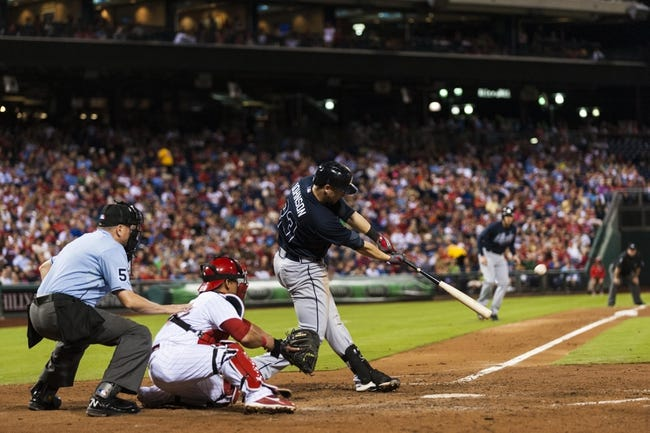 Sep 7, 2013; Philadelphia, PA, USA; Atlanta Braves third baseman Chris Johnson (23) hits an RBI double during the sixth inning against the Philadelphia Phillies at Citizens Bank Park. The Phillies defeated the Braves 6-5. Mandatory Credit: Howard Smith-USA TODAY Sports