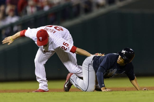 Sep 7, 2013; Philadelphia, PA, USA; Philadelphia Phillies third baseman Cody Asche (25) tags out Atlanta Braves shortstop Andrelton Simmons (19) after Simmons was caught in a rundown during the seventh inning at Citizens Bank Park. The Phillies defeated the Braves 6-5. Mandatory Credit: Howard Smith-USA TODAY Sports