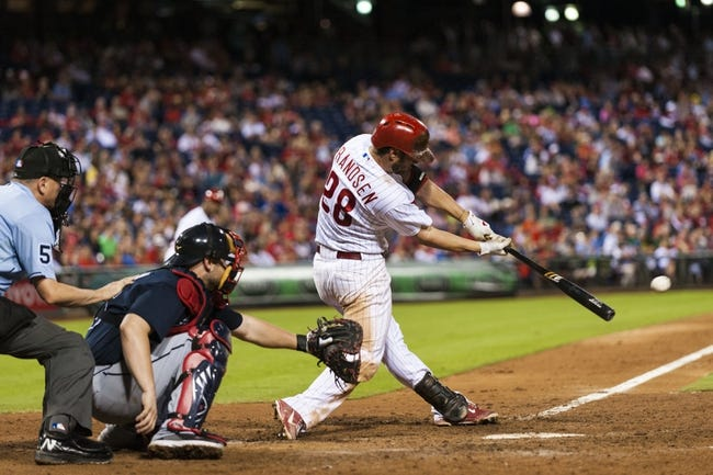 Sep 7, 2013; Philadelphia, PA, USA; Philadelphia Phillies first baseman Kevin Frandsen (28) hits an RBI single during the eighth inning against the Atlanta Braves at Citizens Bank Park. The Phillies defeated the Braves 6-5. Mandatory Credit: Howard Smith-USA TODAY Sports
