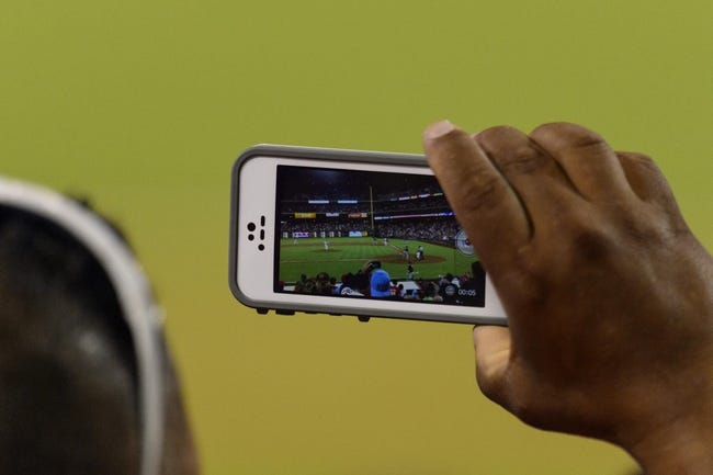 Sep 7, 2013; Philadelphia, PA, USA; A fan records the game on his phone during the ninth inning of a game between the Atlanta Braves  and the Philadelphia Phillies at Citizens Bank Park. The Phillies defeated the Braves 6-5. Mandatory Credit: Howard Smith-USA TODAY Sports