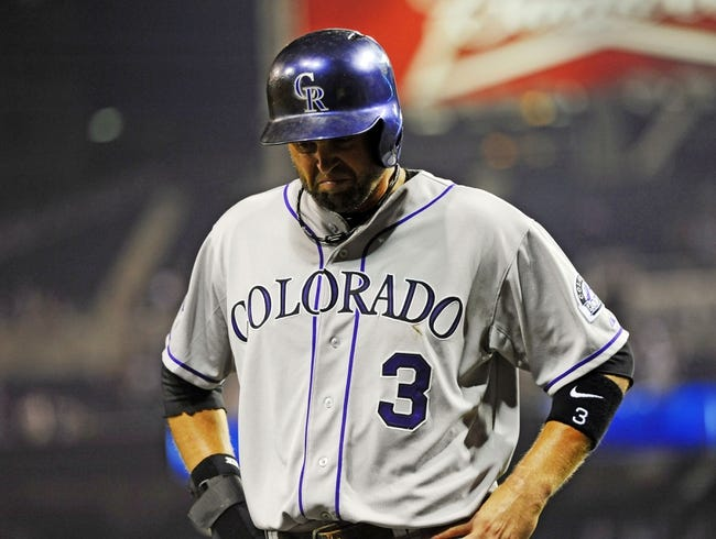 Sep 7, 2013; San Diego, CA, USA; Colorado Rockies right fielder Michael Cuddyer (3) reacts after being doubled off first base for the final out of the game against the San Diego Padres at Petco Park. The Padres won 2-1. Mandatory Credit: Christopher Hanewinckel-USA TODAY Sports