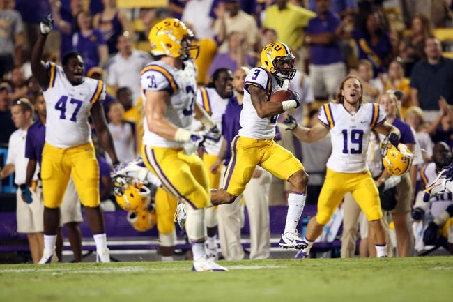 Sep 7, 2013; Baton Rouge, LA, USA; LSU Tigers wide receiver Odell Beckham (3) carries the ball for a 100 yard return on a missed field goal attempt by UAB Blazers in the second half at Tiger Stadium. LSU defeated UAB 56-17. Mandatory Credit: Crystal LoGiudice-USA TODAY Sports