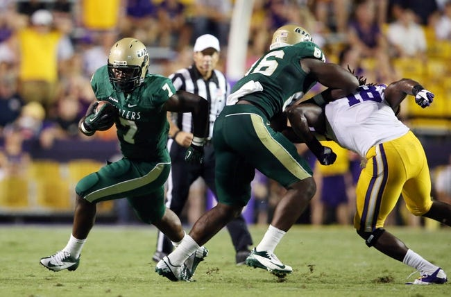 Sep 7, 2013; Baton Rouge, LA, USA; UAB Blazers running back Jordan Howard (7) carries the ball against the LSU Tigers in the fourth quarter at Tiger Stadium. LSU defeated UAB 56-17. Mandatory Credit: Crystal LoGiudice-USA TODAY Sports