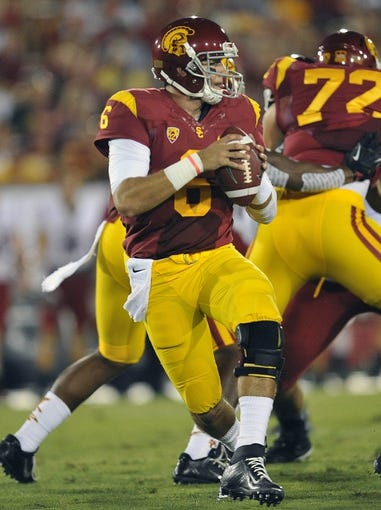 September 7, 2013; Los Angeles, CA, USA; Southern California Trojans quarterback Cody Kessler (6) looks to pass to an open receiver against the Washington State Cougars during the first half at the Los Angeles Memorial Coliseum. Mandatory Credit: Gary A. Vasquez-USA TODAY Sports