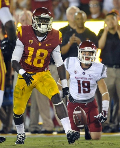 September 7, 2013; Los Angeles, CA, USA; Southern California Trojans safety Dion Bailey (18) celebrates after intercepting a pass against the Washington State Cougars during the first half at the Los Angeles Memorial Coliseum. Mandatory Credit: Gary A. Vasquez-USA TODAY Sports