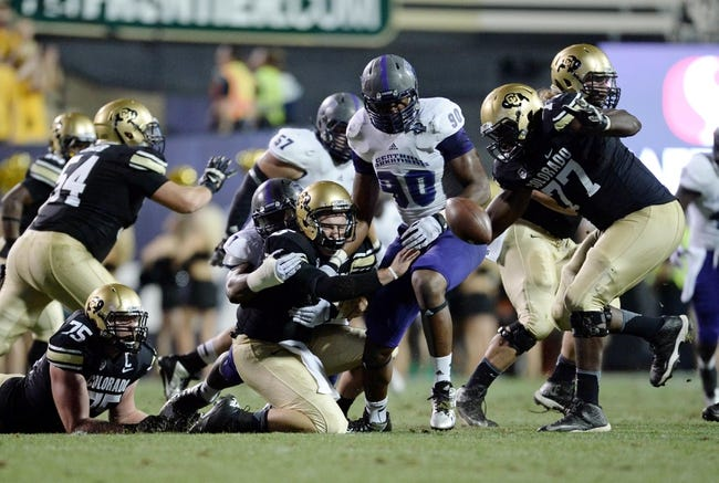 Sep 7, 2013; Boulder, CO, USA; Colorado Buffaloes quarterback Connor Wood (5) fumbles the football in front of offensive linesman Stephane Nembot (77) as Central Arkansas Bears defensive end Jonathan Woodard (90) chases it down in the third quarter at Folsom Field. The Buffaloes defeated the Bears 38-24. Mandatory Credit: Ron Chenoy-USA TODAY Sports