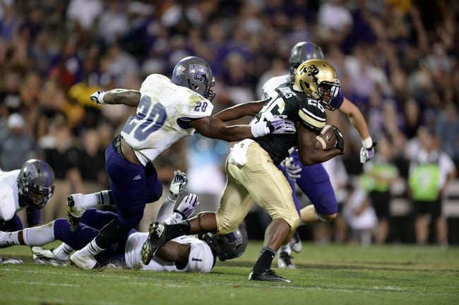 Sep 7, 2013; Boulder, CO, USA; Central Arkansas Bears defensive back Radarius Winston (20) tackles Colorado Buffaloes running back Tony Jones (26) in the fourth quarter at Folsom Field. The Buffaloes defeated the Bears 38-24. Mandatory Credit: Ron Chenoy-USA TODAY Sports