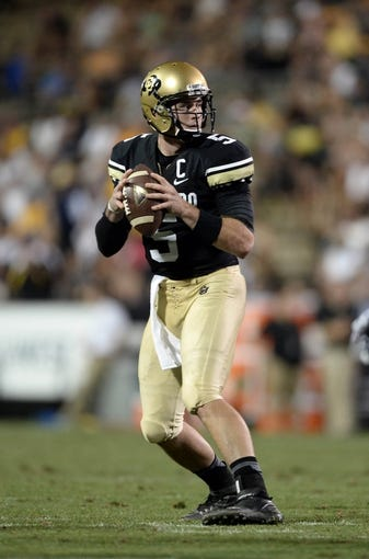 Sep 7, 2013; Boulder, CO, USA; Colorado Buffaloes quarterback Connor Wood (5) prepares to pass in the third quarter against the Central Arkansas Bears at Folsom Field. The Buffaloes defeated the Bears 38-24. Mandatory Credit: Ron Chenoy-USA TODAY Sports