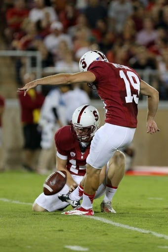 Sep 7, 2013; Stanford, CA, USA; Stanford Cardinal kicker Jordan Williamson (19) kicks the extra point with the hold by punter Ben Rhyne (14) against the San Jose State Spartans during the second quarter at Stanford Stadium. Mandatory Credit: Kelley L Cox-USA TODAY Sports