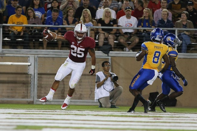Sep 7, 2013; Stanford, CA, USA; Stanford Cardinal running back Tyler Gaffney (25) celebrates after scoring a touchdown against the San Jose State Spartans during the second quarter at Stanford Stadium. Mandatory Credit: Kelley L Cox-USA TODAY Sports