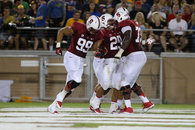 Sep 7, 2013; Stanford, CA, USA; Stanford Cardinal running back Tyler Gaffney (25) celebrates after a touchdown against the San Jose State Spartans during the second quarter at Stanford Stadium. Mandatory Credit: Kelley L Cox-USA TODAY Sports