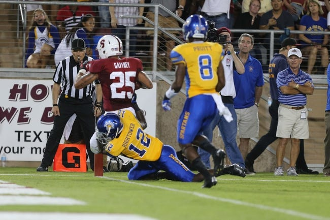 Sep 7, 2013; Stanford, CA, USA; Stanford Cardinal running back Tyler Gaffney (25) scores a touchdown defended by San Jose State Spartans cornerback Forrest Hightower (12) during the second quarter at Stanford Stadium. Mandatory Credit: Kelley L Cox-USA TODAY Sports