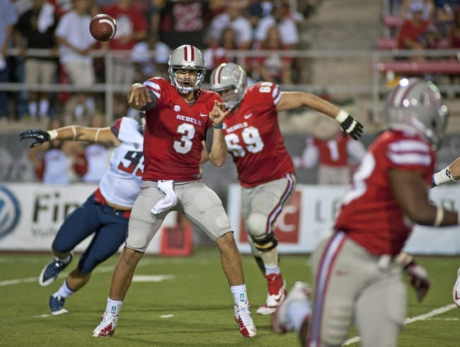 Sep 7, 2013; Las Vegas, NV, USA; UNLV Rebels quarterback Nick Sherry makes a pass attempt against the Arizona Wildcats during an NCAA football game at Sam Boyd Stadium. Mandatory Credit: Stephen R. Sylvanie-USA TODAY Sports