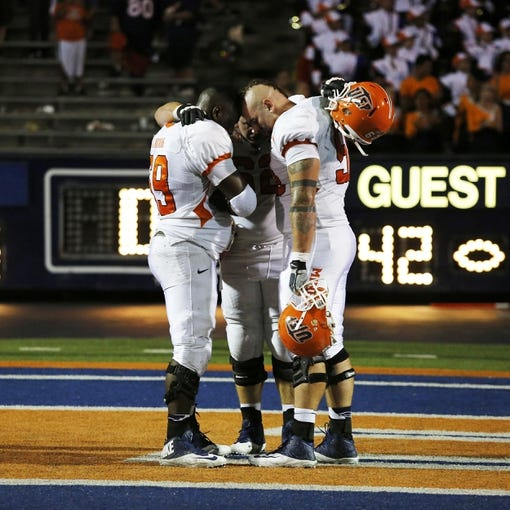 Sep 7, 2013; El Paso, TX, USA; UTEP Miners offensive linemen Jerel Watkins (69), left, Kyle Brown (62), middle, and Brander Craighead (58) embrace after losing to the New Mexico Lobos 42-35 in over time in the season opener at Sun Bowl Stadium. Mandatory Credit: Ivan Pierre Aguirre-USA TODAY Sports