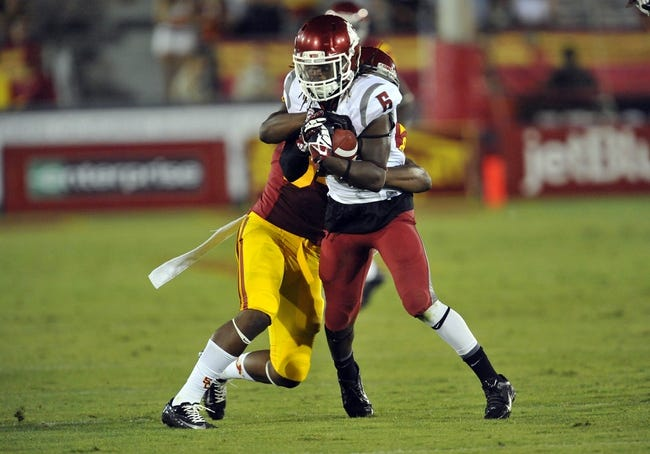 September 7, 2013; Los Angeles, CA, USA; Washington State Cougars cornerback Damante Horton (6) intercepts a pass against the Southern California Trojans during the second half at the Los Angeles Memorial Coliseum. Mandatory Credit: Gary A. Vasquez-USA TODAY Sports