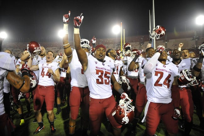 September 7, 2013; Los Angeles, CA, USA; Washington State Cougars defensive back Beau Glover (35) and the Cougars celebrate the 10-7 victory against the Southern California Trojans at the Los Angeles Memorial Coliseum. Mandatory Credit: Gary A. Vasquez-USA TODAY Sports