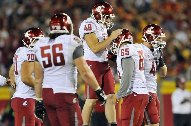 September 7, 2013; Los Angeles, CA, USA; Washington State Cougars kicker Andrew Furney (49) is congratulated after kicking a field goal that puts the Cougars ahead of the Southern California Trojans during the second half at the Los Angeles Memorial Coliseum. Mandatory Credit: Gary A. Vasquez-USA TODAY Sports