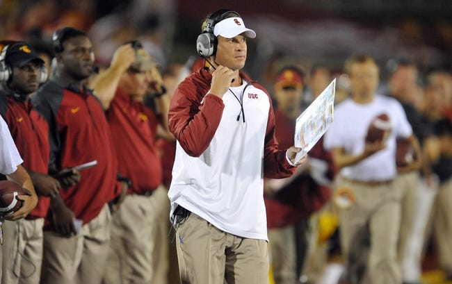 September 7, 2013; Los Angeles, CA, USA; Southern California Trojans head coach Lane Kiffin watches game action against the Washington State Cougars during the second half at the Los Angeles Memorial Coliseum. Mandatory Credit: Gary A. Vasquez-USA TODAY Sports