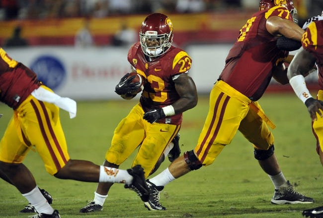September 7, 2013; Los Angeles, CA, USA; Southern California Trojans running back Tre Madden (23) runs the ball against the Washington State Cougars during the second half at the Los Angeles Memorial Coliseum. Mandatory Credit: Gary A. Vasquez-USA TODAY Sports